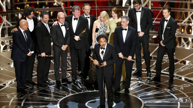 """Alejandro G. Iñárritu, director of """"Birdman"""", accepts the Best Picture Academy Award at the 2015 Oscars. Source: www.nytimes.com"""