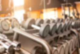 Rows-of-dumbbells-in-the-gym-670378572_2