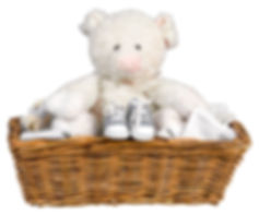 Gifted baby items including stuffed animal, blanket and baby shoes.