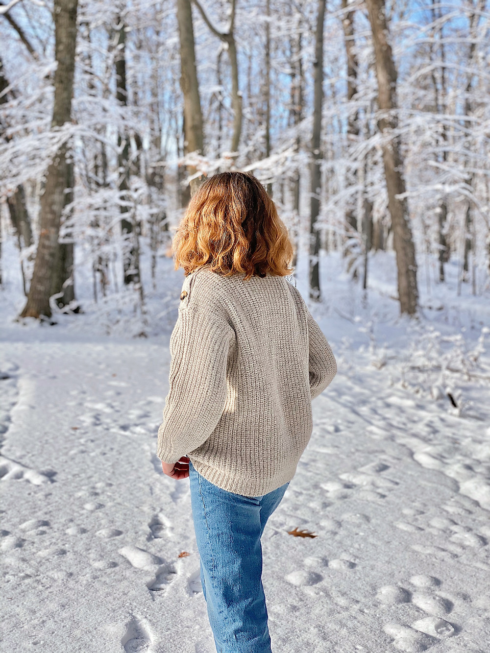 woman in snow covered forest