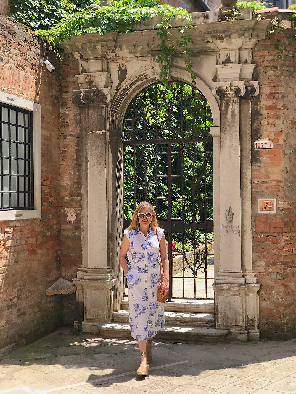 woman in front of a gateway in Venice
