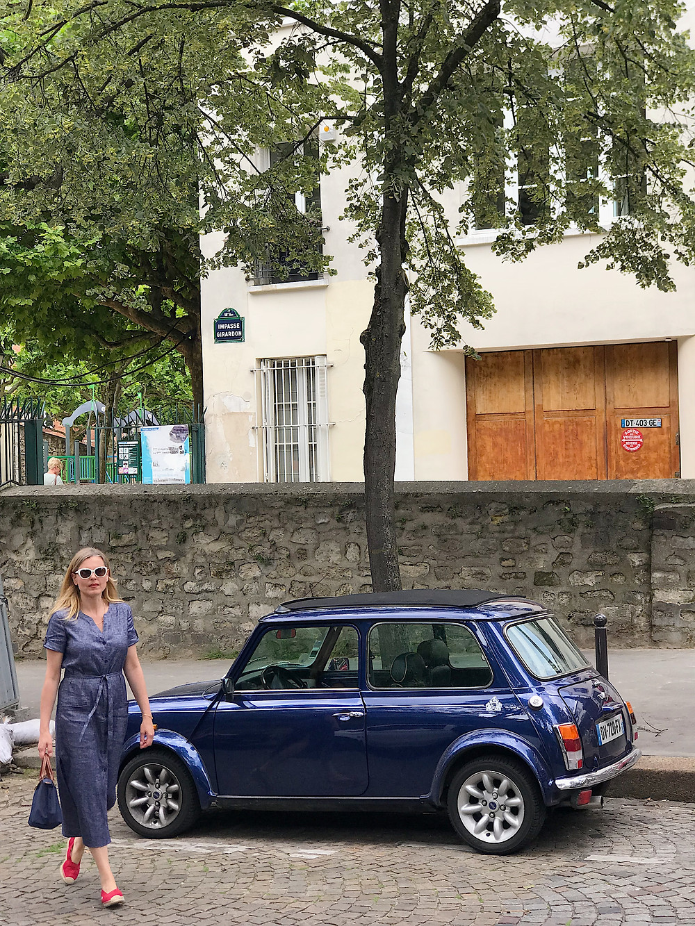 woman by small car