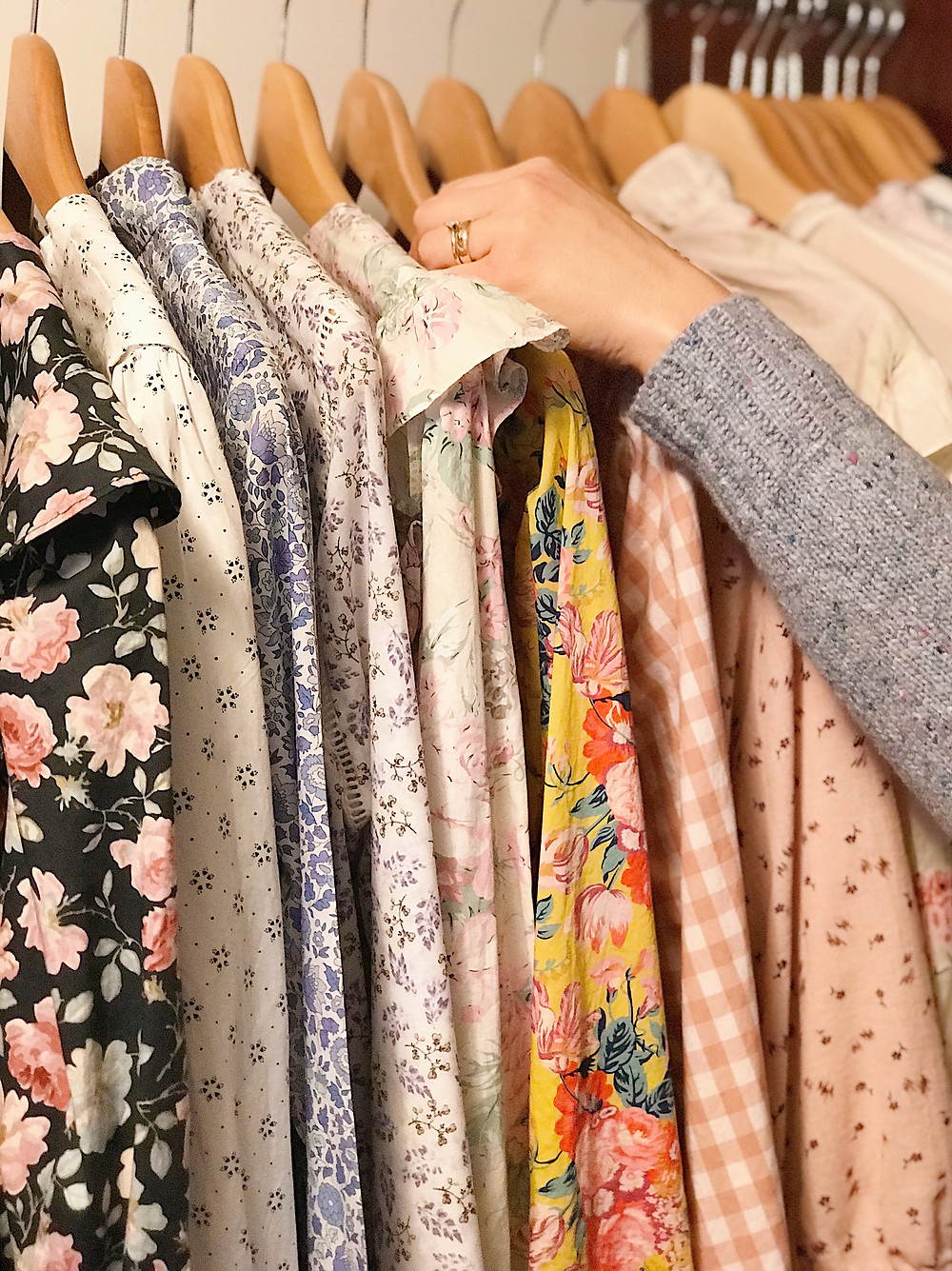 floral blouses hanging in a closet