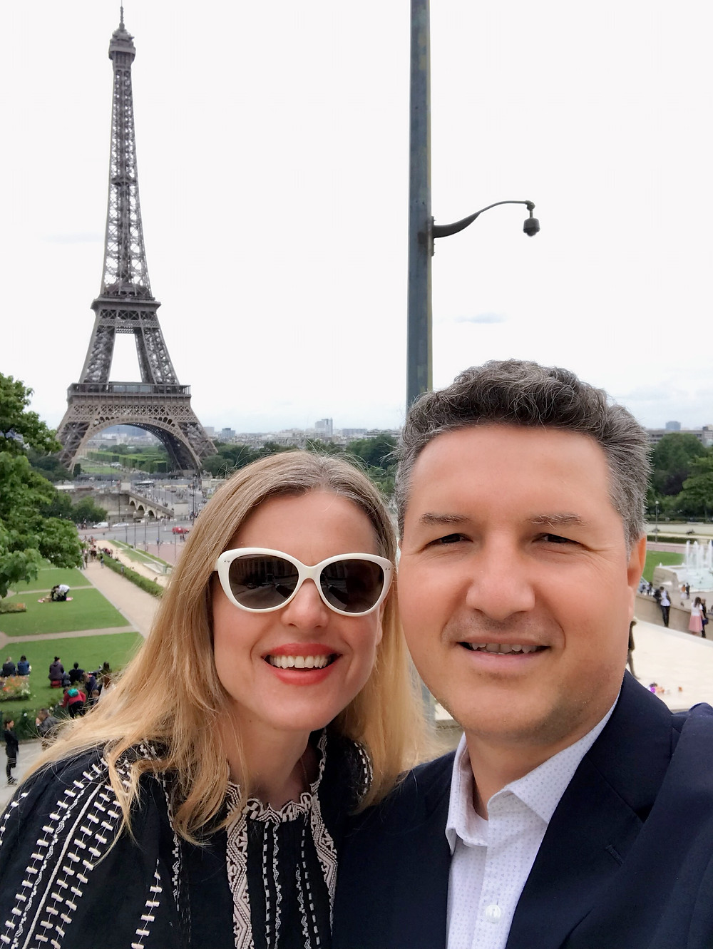 woman and man with Eiffel Tower in background