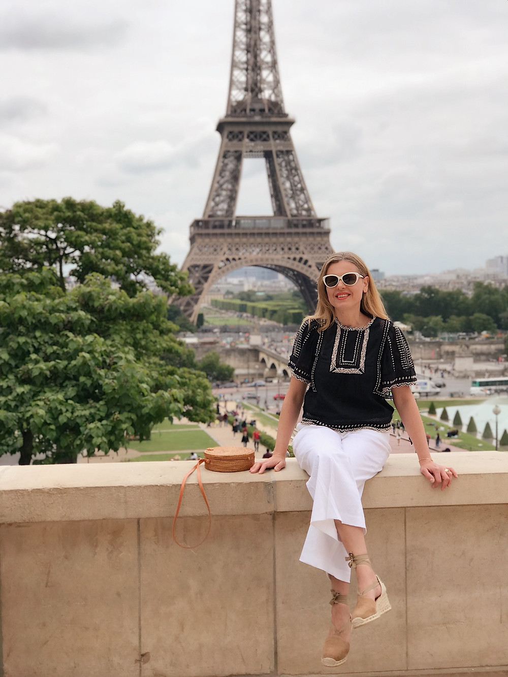 woman with view of Eiffel Tower in back