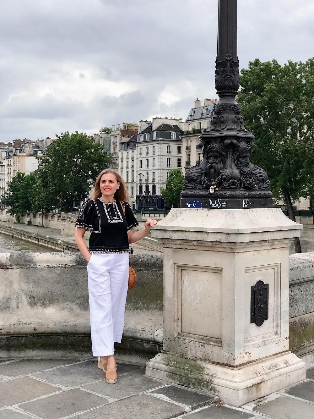 woman on a bridge in Paris