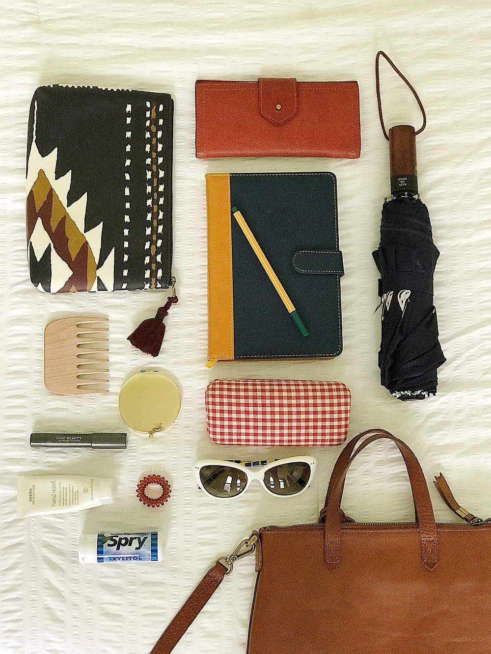 purse, wallet,umbrella, journal, pouch, sunglasses, comb, mirror