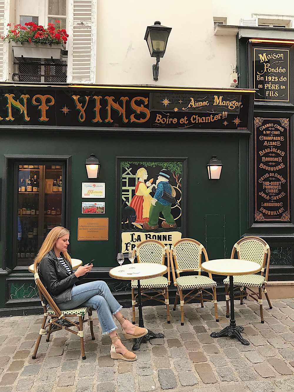 woman at a bistro in Paris