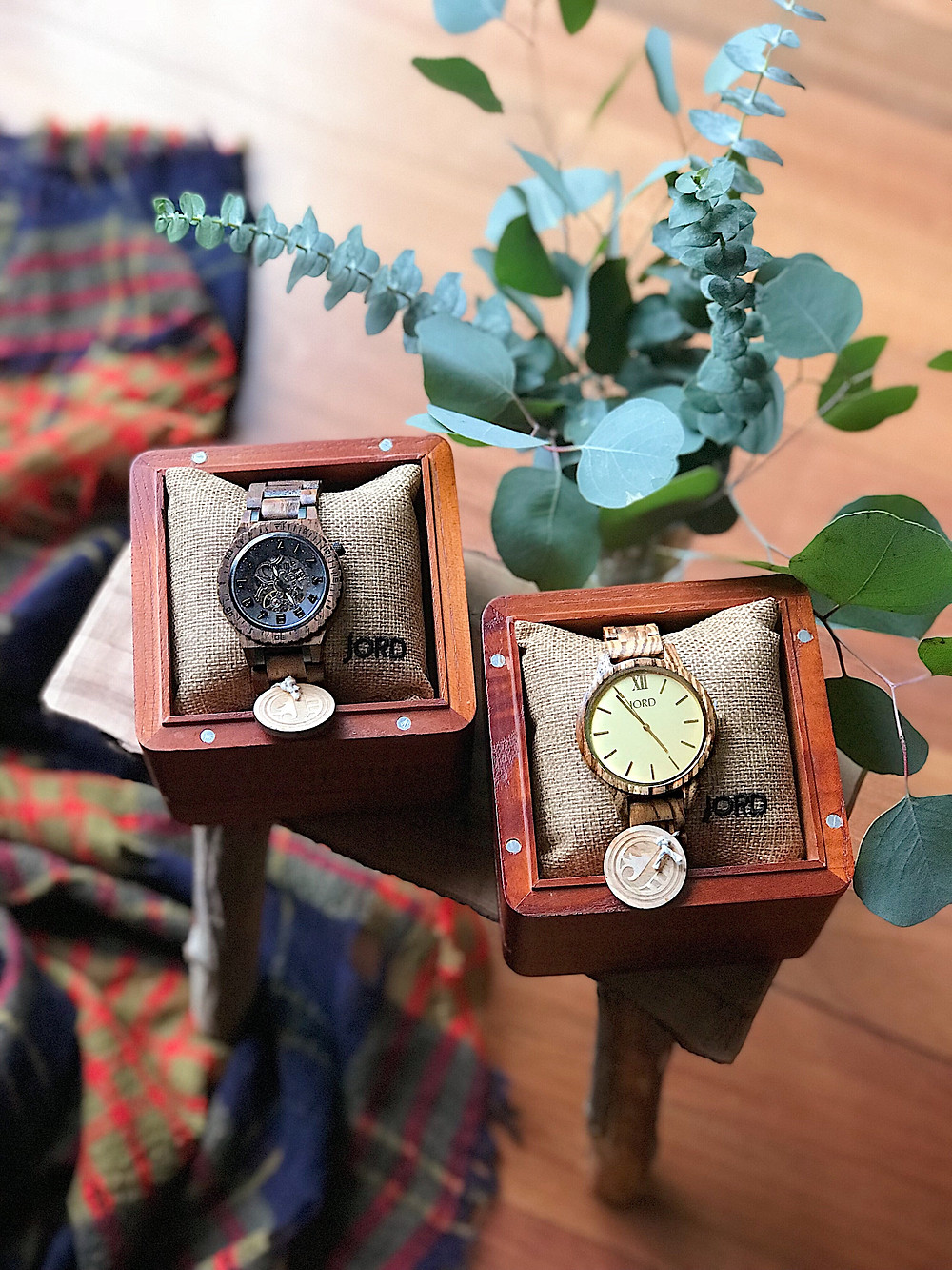 two wood watches in their boxes