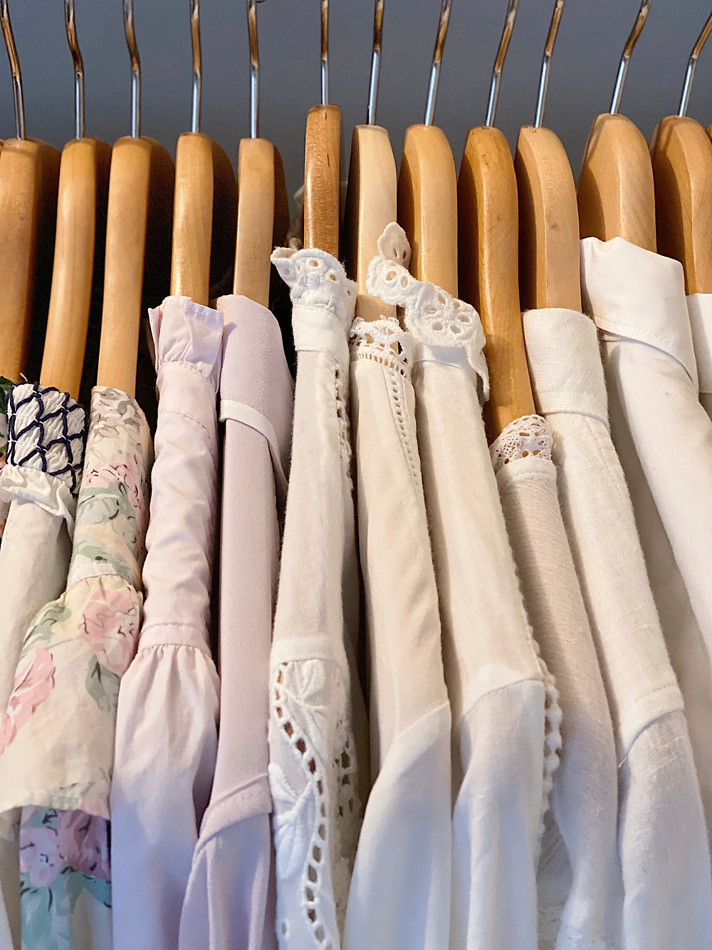 blouses hung in a closet