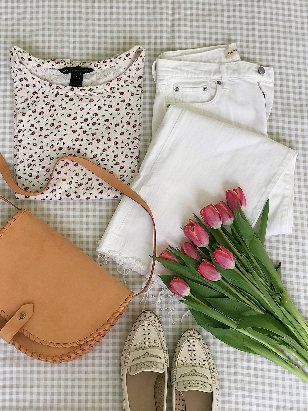 floral top, white jeans, saddle bag, white shoes, tulips