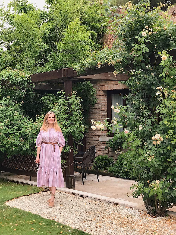 woman in pink dress in a garden