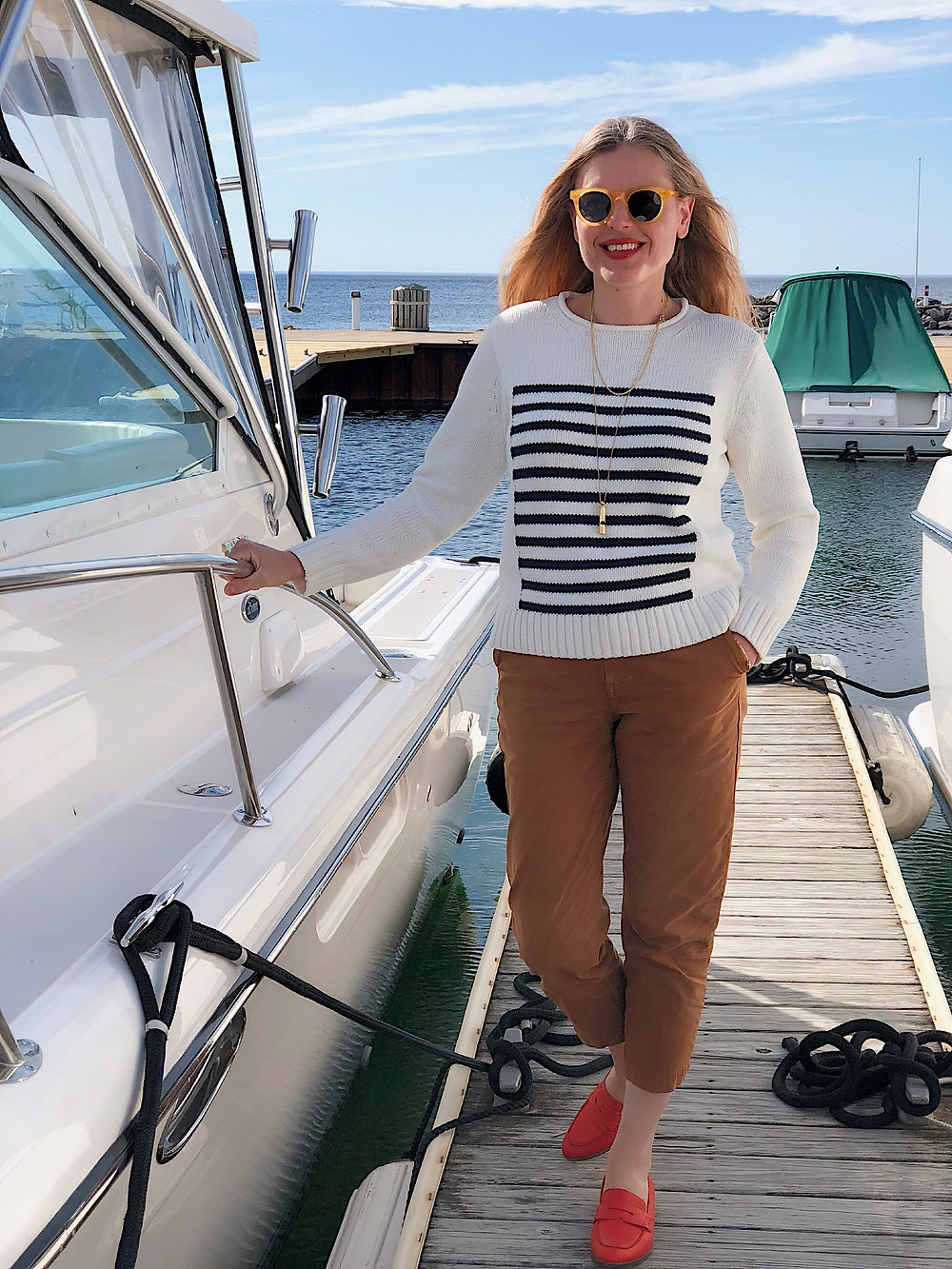 woman on pier by a boat
