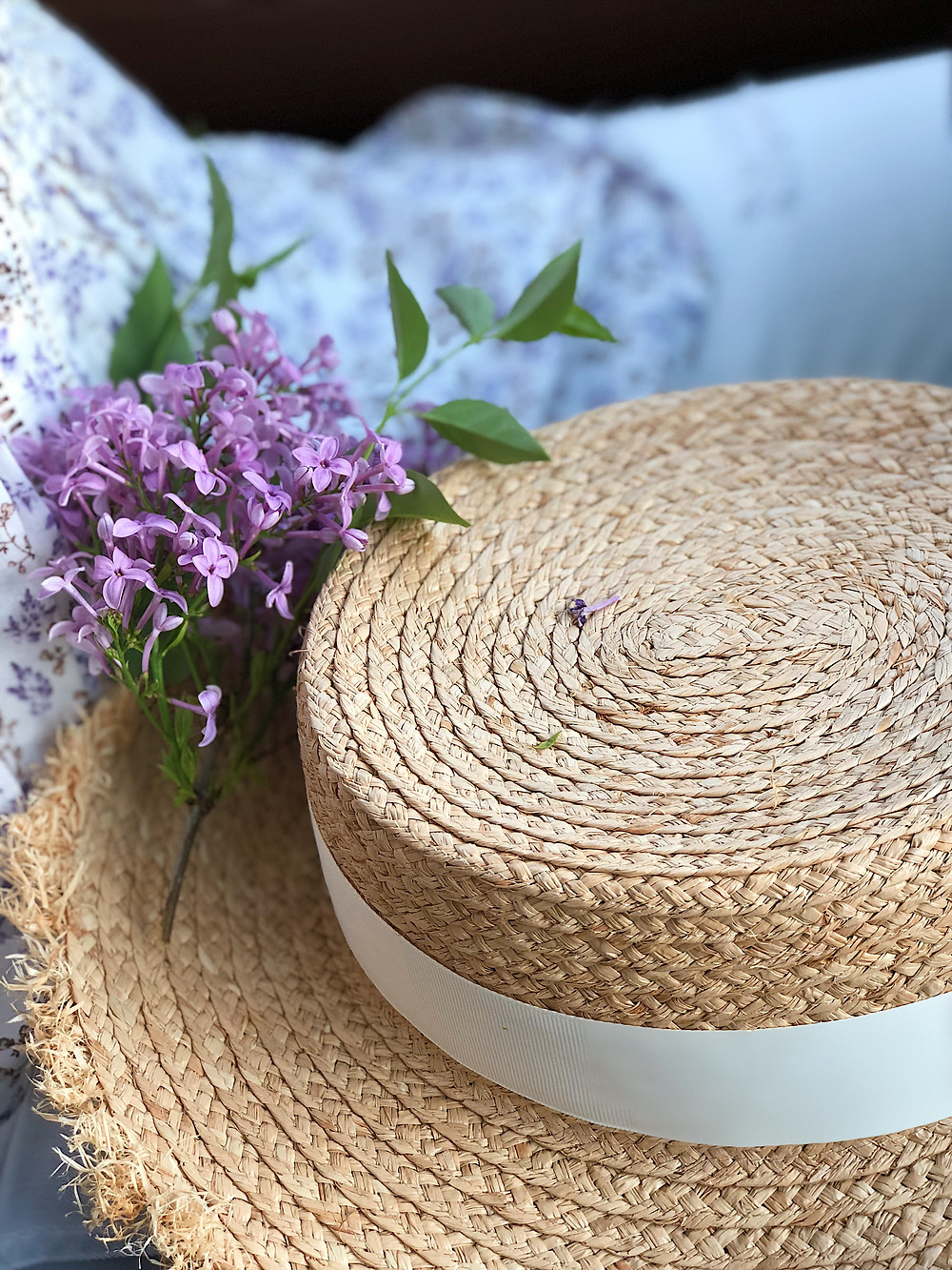 straw hat and lilacs
