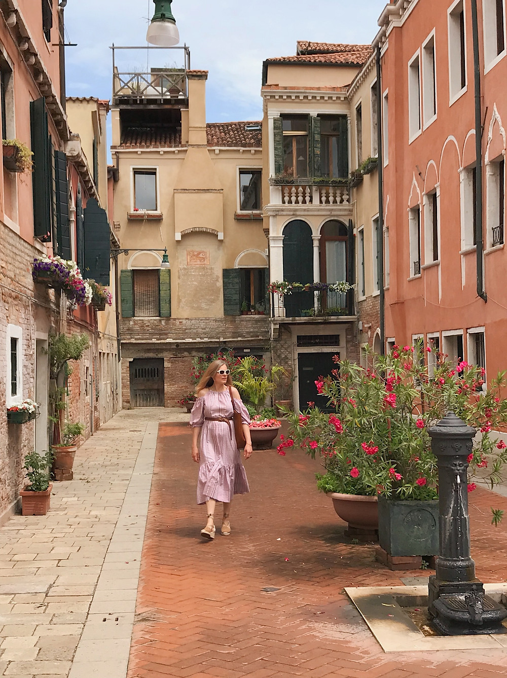 woman in pink dress in Venice