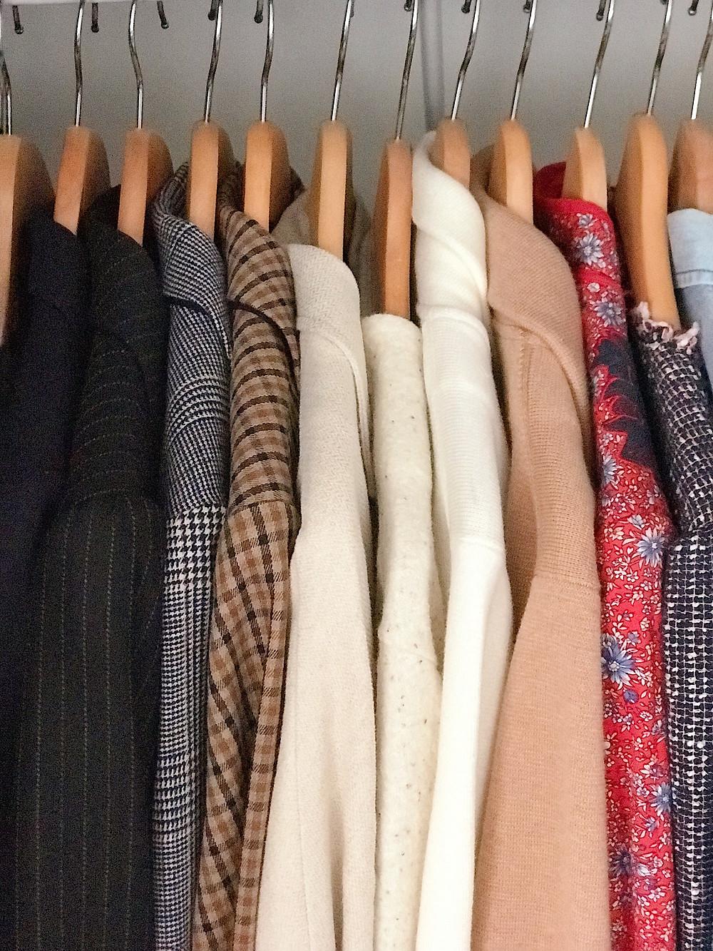 blazers hung in a closet