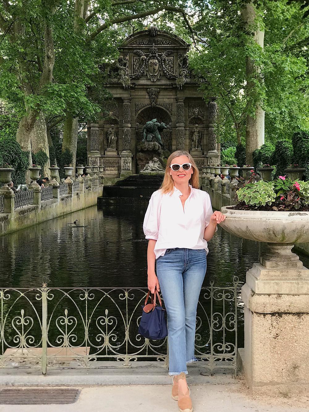 woman by fountain in Jardin du Luxembourg