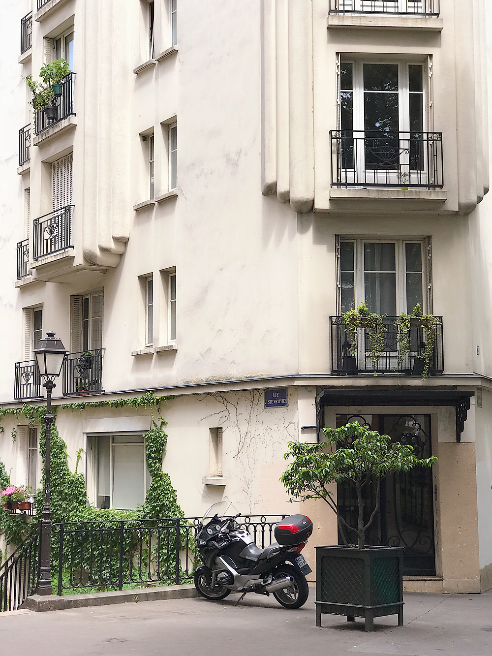 pretty building with motorcycle parked in front