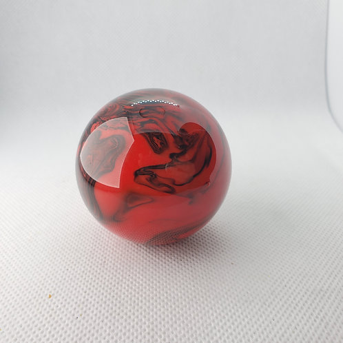 Red and black swirl floor shift ball