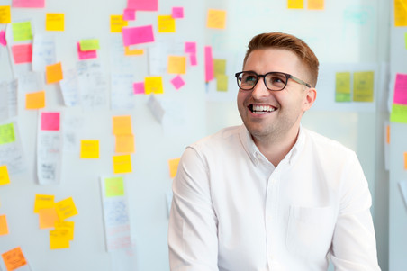 Designer in front of post it notes