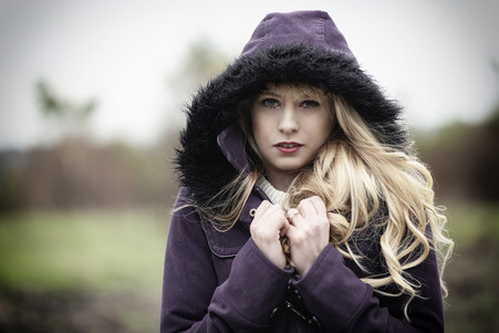 Model with blonde hair and hood up
