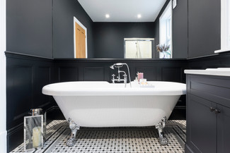 Black bathroon with white bath Notts interior photography