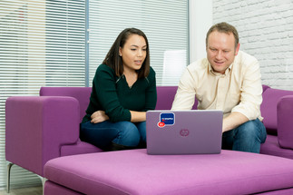 man and woman looking at laptop lincoln corporate photography