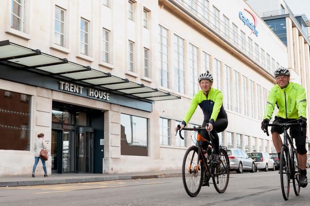 men on bike outside capital one office nottingham commercial photography