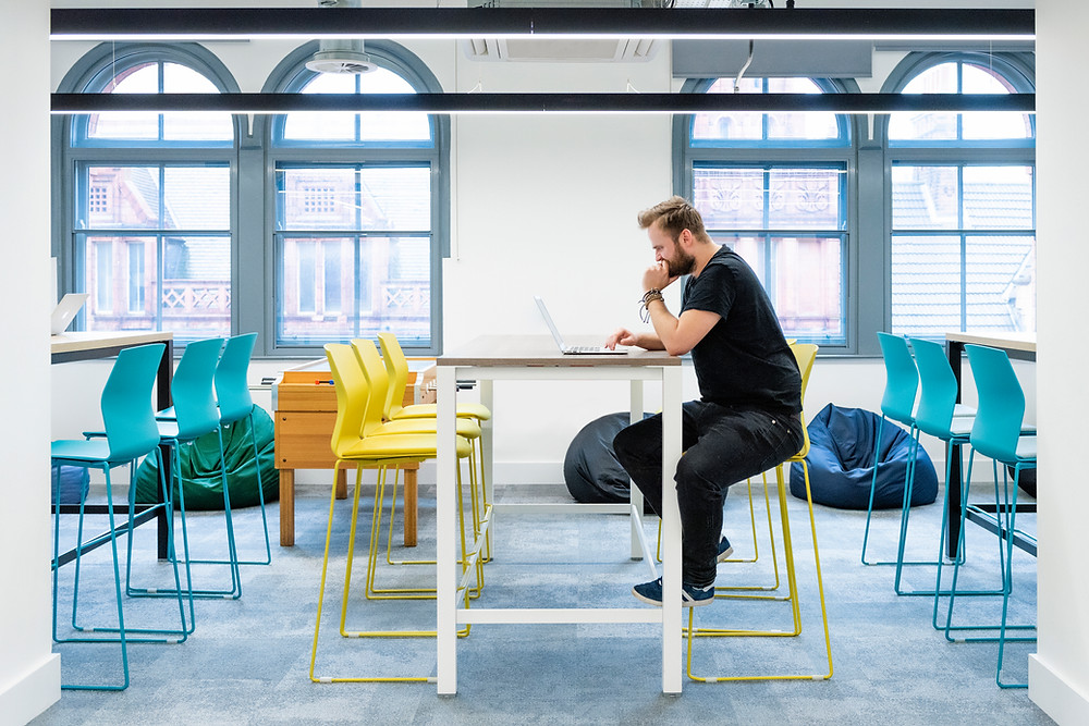 Nottingham commercial photography - man sitting at high desk in open plan office