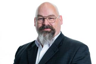 Male headshot with beard white background