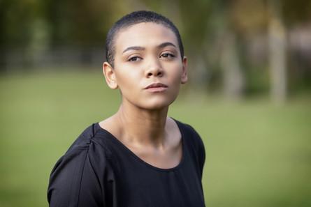 headshot of black actress with short hair