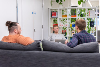 nottingham corporate photography of men sitting on sofa in corporate office