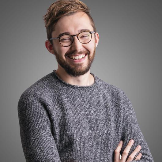 Male LinkedIn headshot photography on grey background