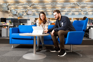 collegues looking at laptop in office derby corporate photography