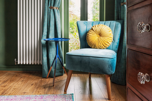 Blue chair next to window nottingham airbnb photography