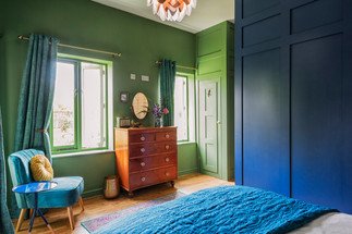 Lincoln interior photography bedrrom with green walls and blue waredrobe
