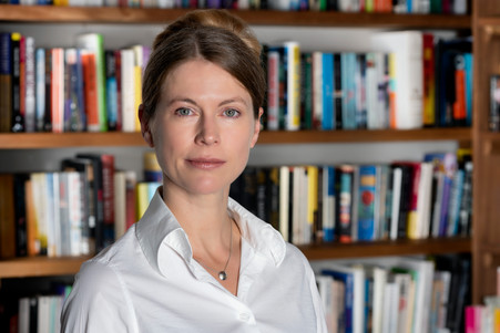 Female corporate executive in front of bookcase