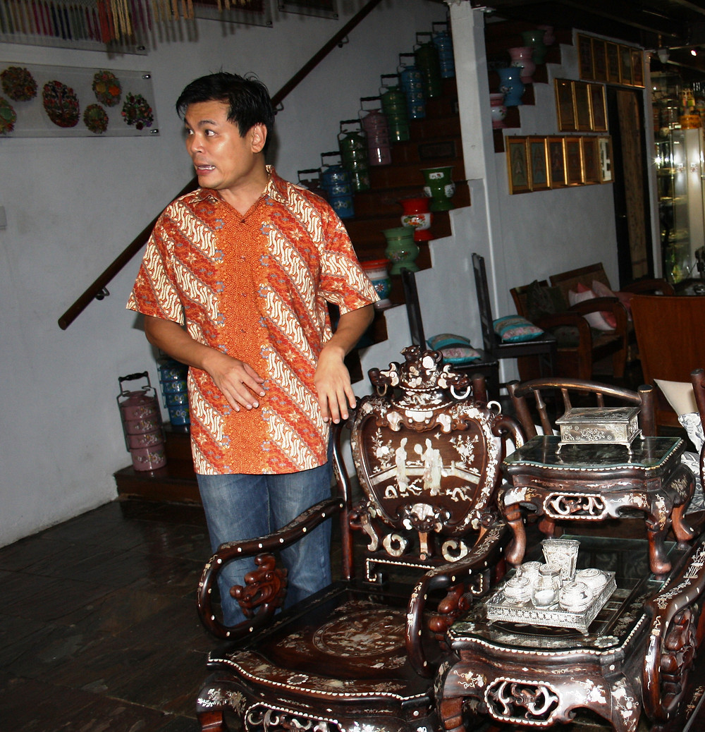 Alvin Yapp shows off his mother-of-pearl inlaid chairs