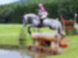 Mac Equestrian image of a grey horse jumping into the water at Blair Castle horse trials