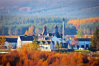 Image of Dalwhinnie distillery with autumn colours countryside