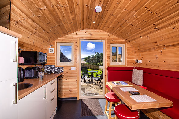 Laggan Glamping pod interior looking out to a sunny day