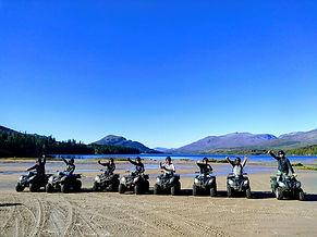 Image of 8 quad bikes on Loch Laggan in bright sunshine