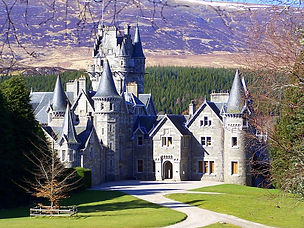 Image of Ardverikie House in bright sunshine with winter countryside colours