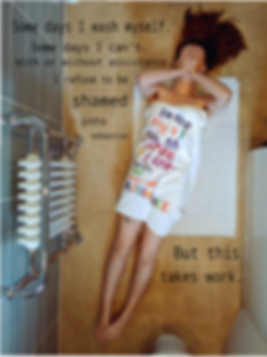 """Centre frame is Charlie, a white womxn in her late 20s with medium length brown hair seen from above, lying diagonally across the image on top of a white shower mat which is on a sand coloured tilled bathroom floor. Her upper body is wrapped in a white towel with coloured writing across it which reads: """"Some days I/ Wash/ Some I Can't/ With/ Or/ Without/ Assistance"""" in purple, red, green, yellow, blue, orange. A circular tattoo is partially covered by the towel. Black text is also on the upper left of the image which reads: """"Some days I wash myself/ Some days I can't. / With or without assistance./ I refuse to be/ shamed./ into/ exhaustion."""" And over the bottom right of the image: """"But this/ takes work."""" The womxn covers her face with her hands. On the left-hand side of the frame is a white radiator with chrome pipes and valves. At the bottom of the frame is the white pedestal of a toilet, whilst the side of a white bath runs along the right side of the image."""