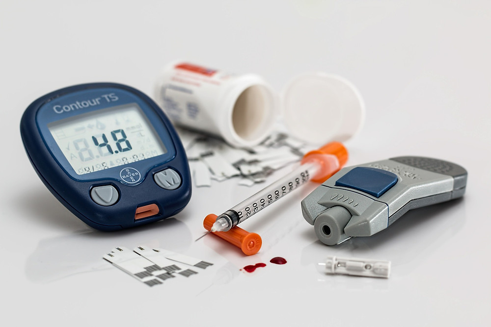 diabetic instruments. Glucose monitor, test strips and needle.