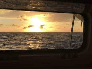 Sunset view through cabin porthole