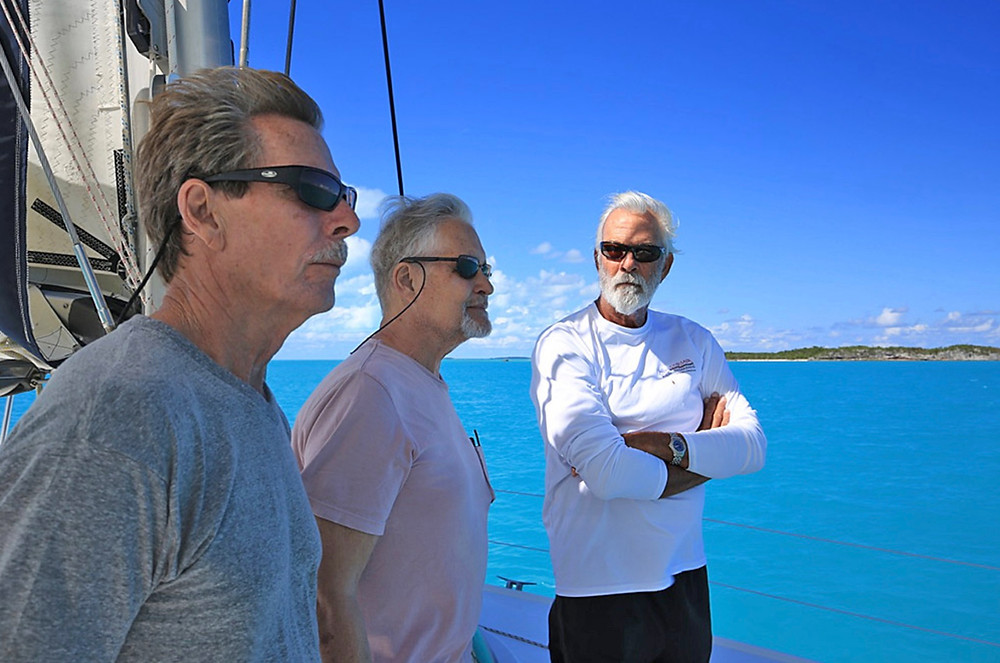 Men on a catamaran at sea