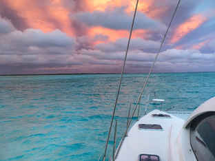 Pink Skies Clouds Turquoise sea Bahamas Sailing Catamaran Charters