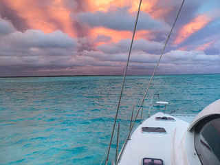 Pink Skies Clouds Turquoise sea Bahamas Sailing Catamaran Charters