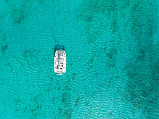 Drone Top View turquoise sea Bahamas Sailing Catamaran Charter